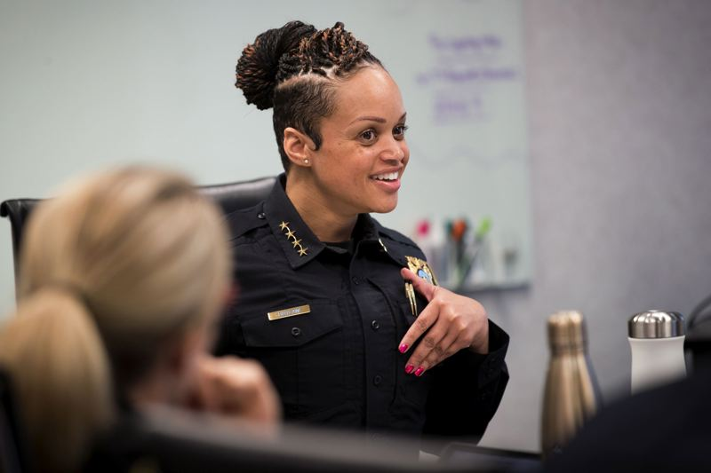 TRIBUNE PHOTO BY JAIME VALDEZ - Portland Police Bureau Chief Danielle Outlaw lets her staff know that she found out that she'll will be knighted during the Rose Festival week during a weekly meeting at Central Precinct.