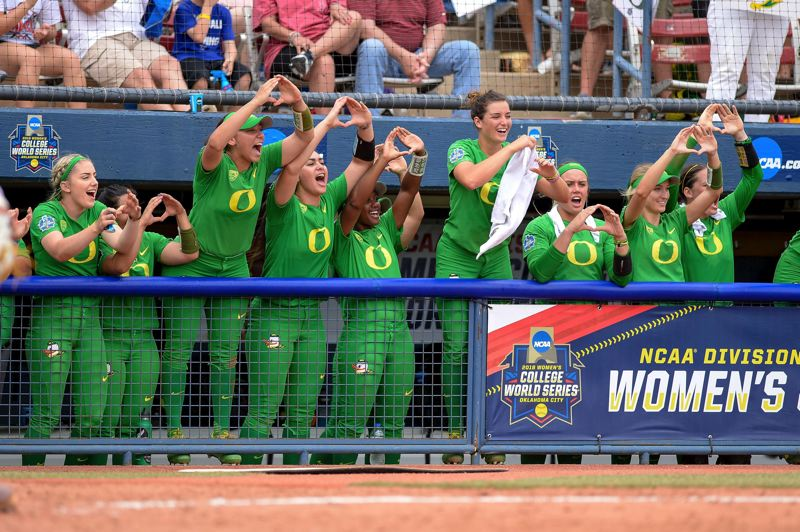 TRIBUNE PHOTO: JOSHUA GATELEY - Oregon players cheer as the Ducks get through the first round Thursday with an 11-6 victory over Arizona State in the Women's College World Series at Oklahoma City.