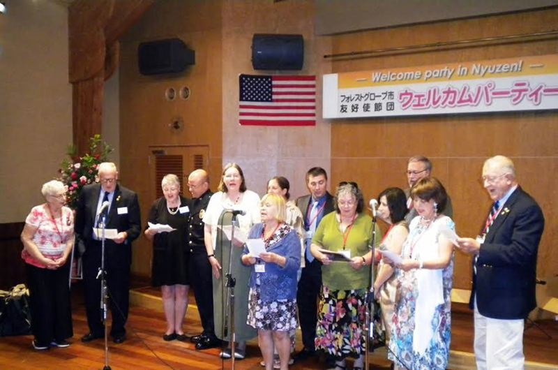 FILE PHOTO - Delegates from Forest Grove sing to their hosts in Nyuzen, Japan, during a sister city visit in 2015.