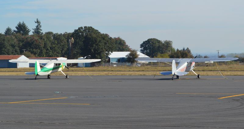 SPOTLIGHT FILE PHOTO - Small aircraft are parked outside a hangar at the Scappoose Industrial Airpark. Some aviation businesses have said the cost of constructing new hangars is too expensive, due the cost of required fire suppression systems.