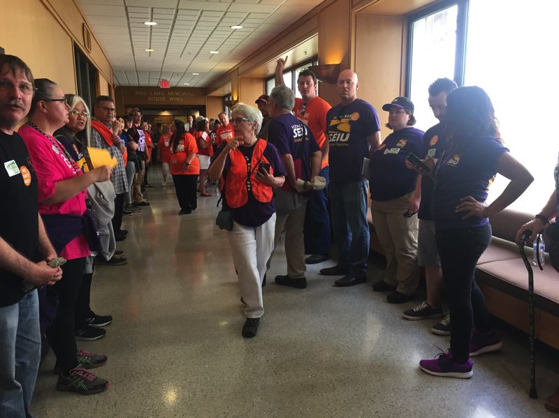PARIS ACHEN/PAMPLIN FILE PHOTO - Union members protest in the halls of the Oregon State Capitol in Salem over inequity in the Oregon tax system during the legislative session June 7, 2017.