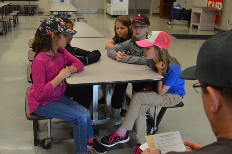 SPOTLIGHT FILE PHOTO - Students in the St. Helens School District practice for an Oregon Battle of the Books competition during the 2017-18 competition season. Participation in the OBOB competitions is voluntary and students often split up reading assignments with their teammates.