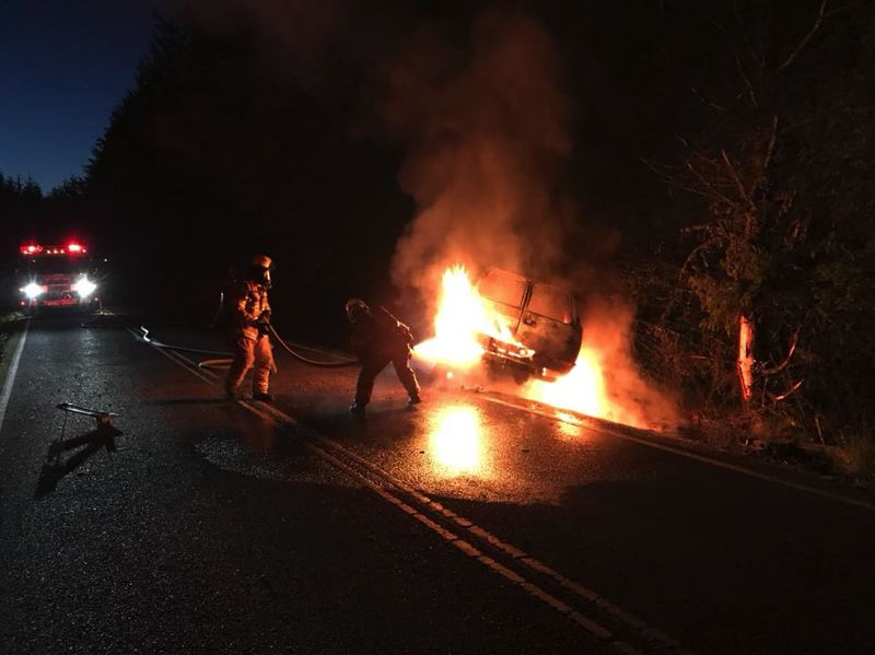 PHOTO COURTESY OF COLUMBIA RIVER FIRE AND RESCUE - Columbia River Fire and Rescue crews responded to a single-vehicle crash on Neer City Road on May 25. The SUV caught fire following the crash, but the driver was not injured and crews put out the fire in less than 20 minutes.