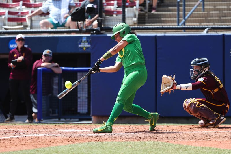 COURTESY: ERIC EVANS PHOTOGRAPHY - Ducks outfielder Shannon Rhodes connects during Thursday's first-round Women's College World Series victory against Pac-12 rival Arizona State.