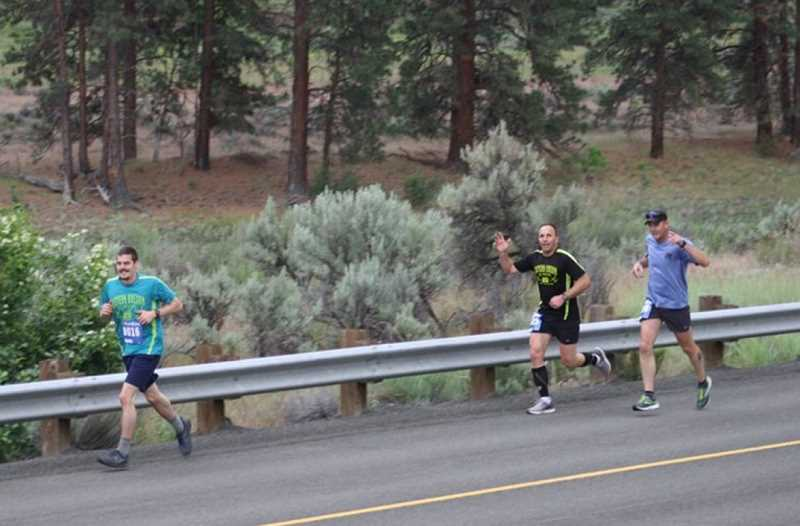 PHOTO COURTESY OF JOHN WAGNER - Kelly Lawson, center, and James Blanchard, right, both of Prineville, follow another runner up the John Day River during last Saturday's Eastern Oregon Half Marathon. Lawson finished in fifth place with a time of 1:34:00, while Blanchard was eighth in 1:40:44.