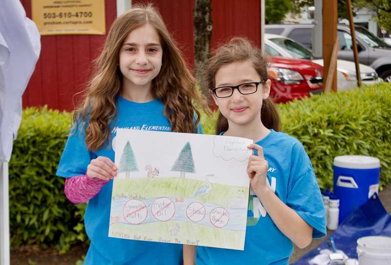OUTLOOK PHOTO: CHRISTOPHER KEIZUR - Melissa Kautush, left, and Megan McMurry, both students at Highland Elementary School, co-designed an educational stormwater mural.