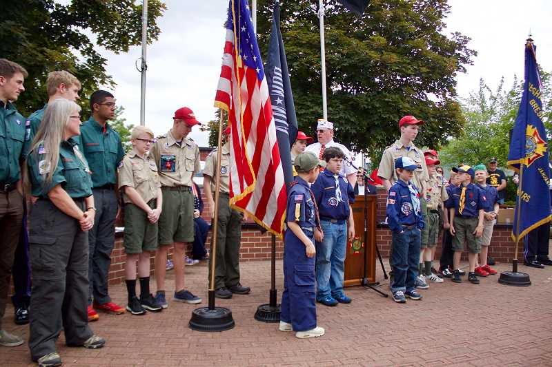 OUTLOOK PHOTO: CHRISTOPHER KEIZUR - The Cascade Pacific Council Boy Scouts were honored during the ceremony. They helped present the colors on Memorial Day and cleaned the Heroes Memorial.