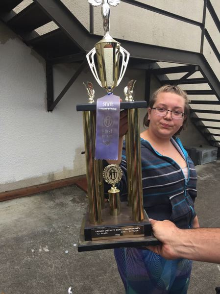 SUBMITTED PHOTO - Milwaukie High School sophomore Kayla Gilmore with a trophy she recovered from the school's dumpster.