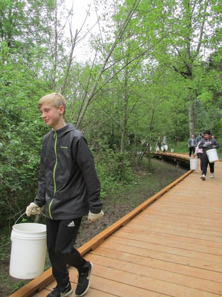 OUTLOOK PHOTO: TERESA CARSON - A boardwalk is the latest addition to the Wildside, 13 acres of restored nature habitat at Pleasant Valley Elementary School.