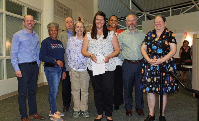 CONTRIBUTED PHOTO - Tai Quirke, surrounded by members of the Gresham-Barlow School Board and the superintendent, as she received the districts excellence in teaching award in May.