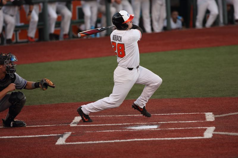 TRIBUNE PHOTO: SCOTT CASSIDY - Kyle Nobach launches his home run for Oregon State in its 9-3 Corvallis regional victory Friday night against Northwestern State.