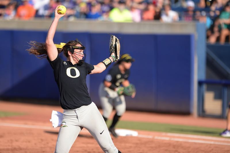 TRIBUNE PHOTO: JOSHUA GATELEY - Megan Kleist pitches for Oregon against Washington on Friday.