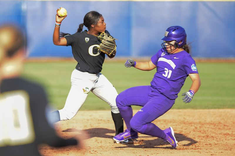 TRIBUNE PHOTO: JOSHUA GATELEY - Shorstop DJ Sanders of Oregon makes a pivot play at second base against Washington.