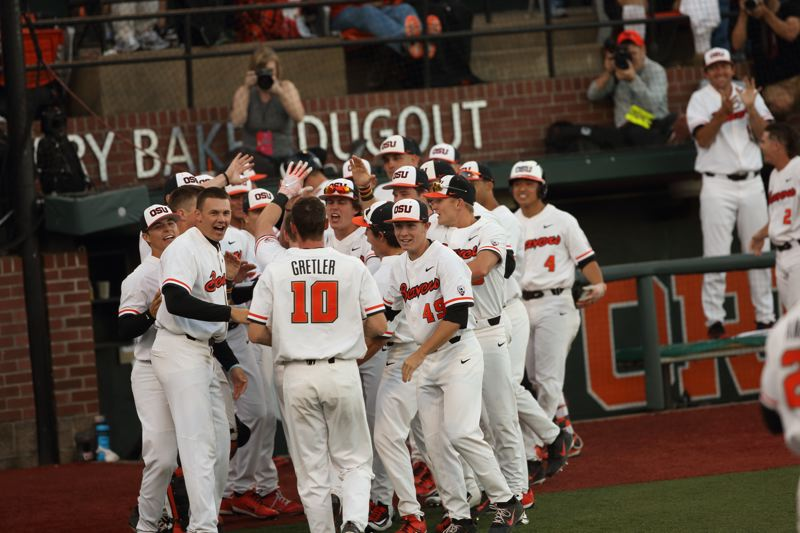 TRIBUNE PHOTO: SCOTT CASSIDY - Oregon State players celebrate a home run by Kyle Nobach.