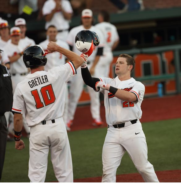 TRIBUNE PHOTO: SCOTT CASSIDY - Oregon State's Kyle Nobach (right) is congratulated at the plate by Michael Gretler after hitting a home run.