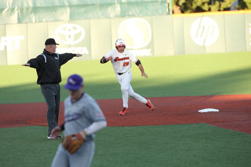 TRIBUNE PHOTO: SCOTT CASSIDY - Jack Anderson of Oregon State rounds second base.
