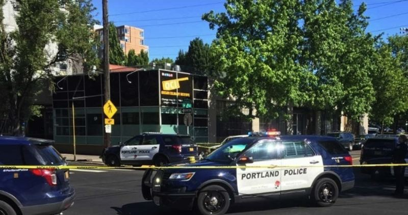(Image is Clickable Link) KOIN 6 NEWS PHOTO - Portland Police squad cars surround the Oregon Culinary Institute on Saturday, June 2, after reports of a fatal shooting.