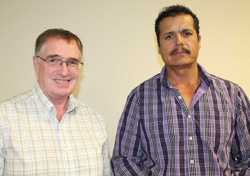 HOLLY M. GILL - The two-man team of Annan Priday, left, and Refugio Orozco won the first place men's prize for the Movin' Mountains Slimdown Challenge at an awards ceremony May 24.