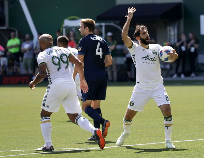 TRIBUNE PHOTO: JONATHAN HOUSE - Diego Valeri (right) of the Portland Timbers reacts to a call during Saturday's MLS game at Providence Park against the Los Angeles Galaxy.