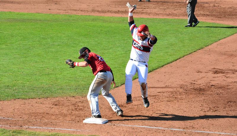 TIMES PHOTO: MATT SINGLEDECKER - Westview senior third baseman Mante Woods tries to jump on first base against Clackamas.