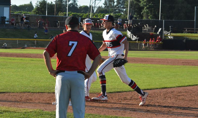 TIMES PHOTO: MATT SINGLEDECKER - Westview freshman Mason Guerra tags first base for the final out of the Class 6A state championship against Clackamas.