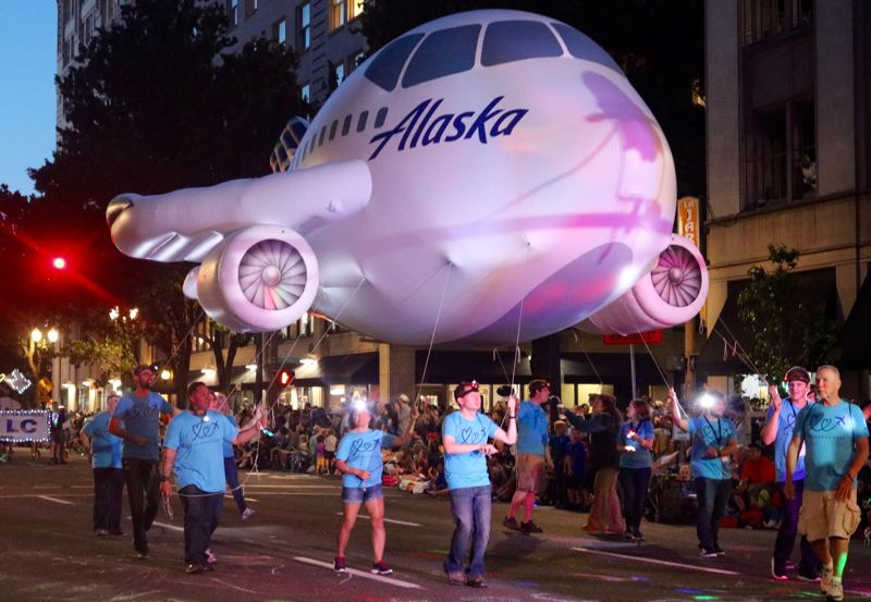 TRIBUNE PHOTO: ZANE SPARLING - An Alaska Airlines inflated jet travels along during the 2018 Starlight Parade on Saturday, June 2 in Portland.