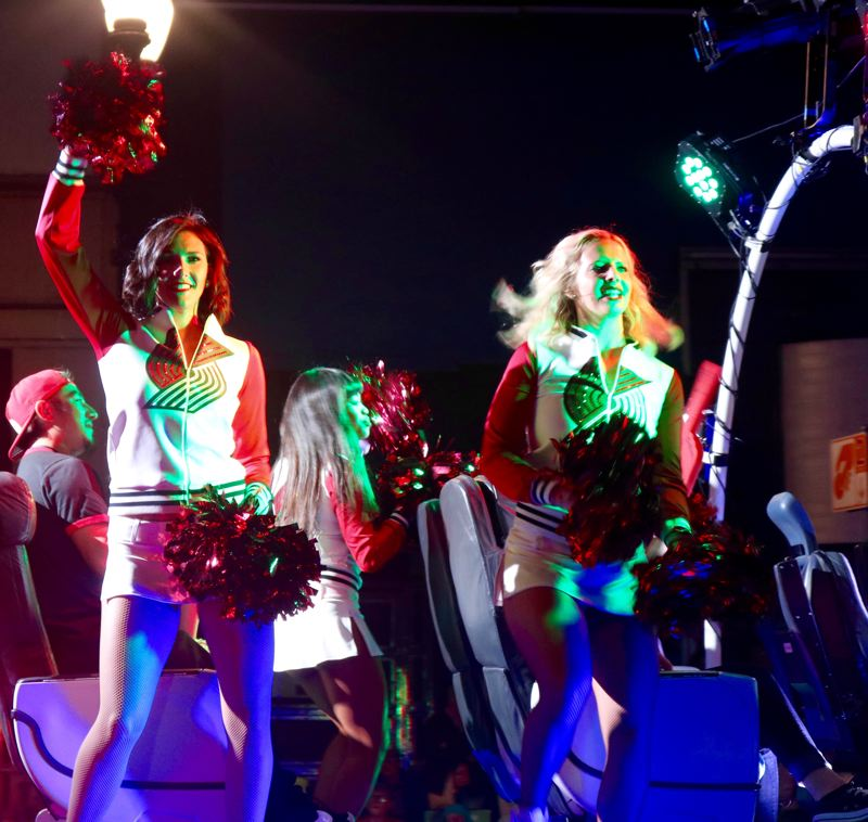 TRIBUNE PHOTO: ZANE SPARLING - Trail Blazer cheerleaders pump up the crowd during the 2018 Starlight Parade on Saturday, June 2 in Portland.