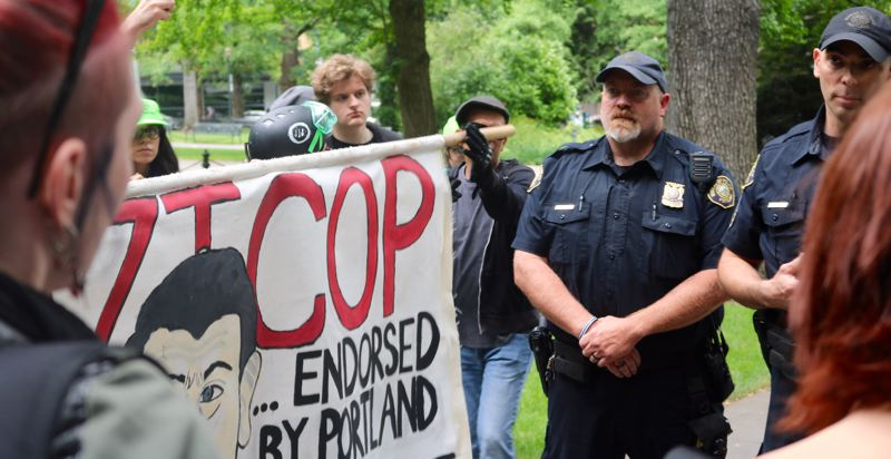 TRIBUNE PHOTO: ZANE SPARLING - Protesters and Portland Police officers face off at Terry Schrunk Plaza on Sunday, June 3.