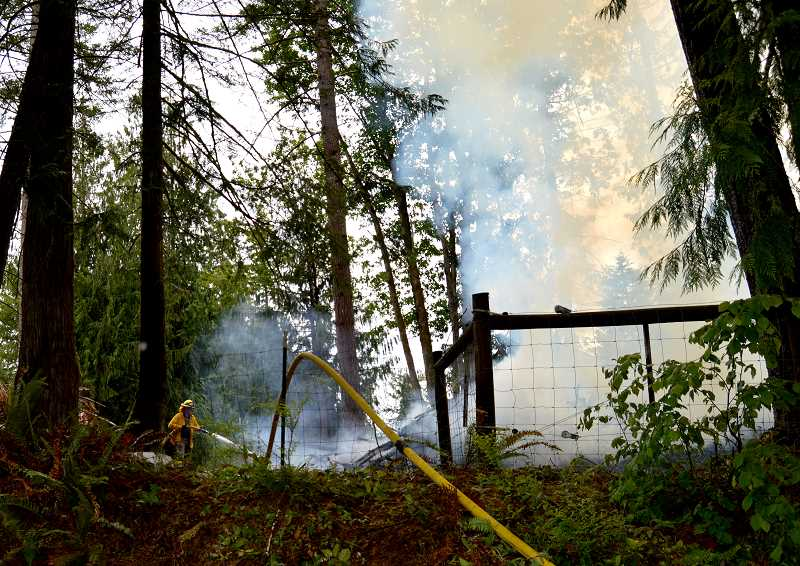 PIONEER PHOTO: CINDY FAMA - The fire was deemed contained by 3:40 p.m.