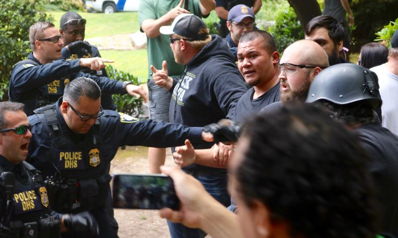 TRIBUNE PHOTO: ZANE SPARLING - Tusitala 'Tiny' Toese, center, attempts to enter Terry Schrunk Plaza on Sunday, June 3 in downtown Portland.