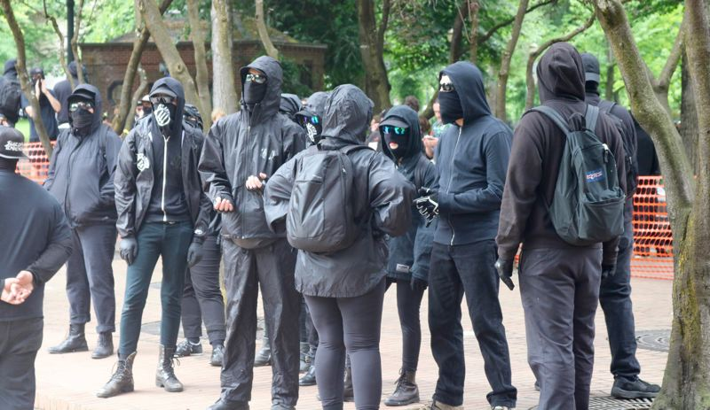 TRIBUNE PHOTO: ZANE SPARLING - Members of the anti-fascist group known as Antifa gather at Lownsdale Square on Sunday, June 3 in Portland.