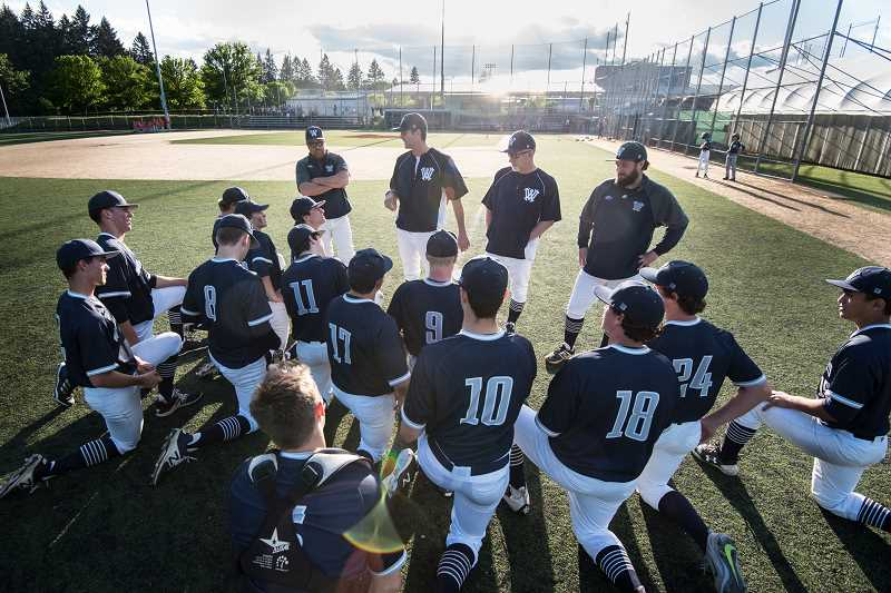 SUBMITTED PHOTO: GREG ARTMAN - The 2018 Wilsonville Wildcats post game, listening to coach Bryn Card.