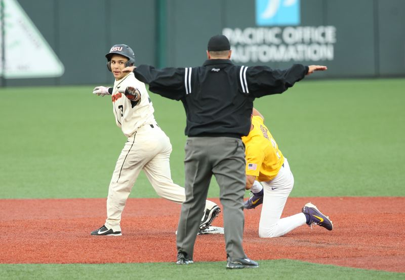 TRIBUNE PHOTO: SCOTT CASSIDY - Oregon State's Nick Madrigal and the umpire both agree he is safe with a steal of second base during Sunday's 12-0 victory over LSU. The third-seeded Beavers now play host to Minnesota in a best-of-three NCAA super regional.