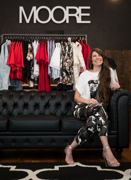 PAMPLIN MEDIA GROUP: JAIME VALDEZ - Andrea Moore Beaulieu, owner of MOORE Custom Goods, in her store at Southeast 28th Avenue. She designs and makes and retails her twice-yearly streetwear line,  bringing out of state savvy and a post-chain store retail business model.