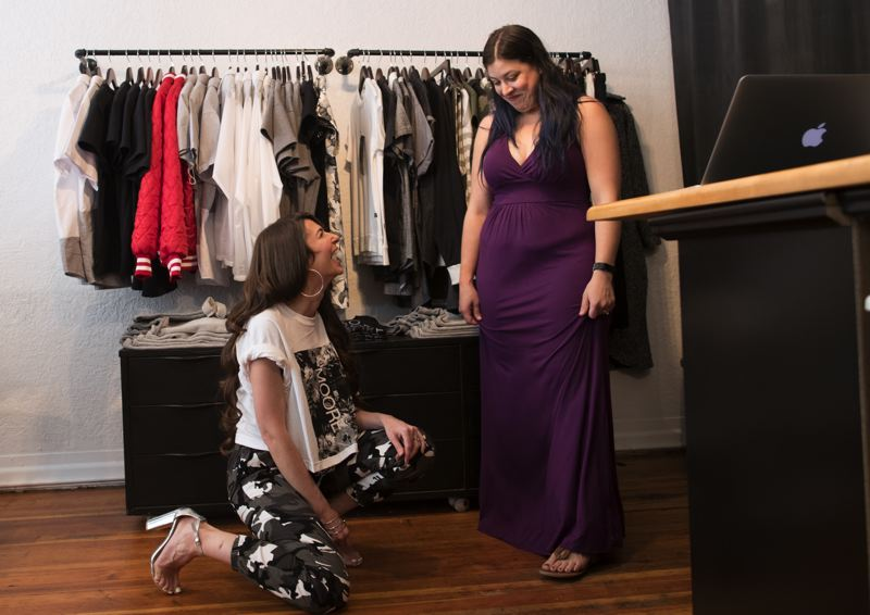 PAMPLIN MEDIA GROUP: JAIME VALDEZ - Andrea Moore Beaulieu, owner of MOORE Custom Goods, with a customer in her store at Southeast 28th Avenue. She designs custom garments but won't do suiting or anything typically bridal, such as beaded dresses.