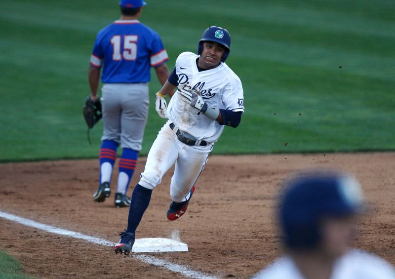 Gio Diaz of the Portland Pickles rounds third base in the team's first game as a member of the West Coast League.