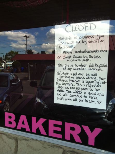 PAMPLIN FILE PHOTO - Aaron and Melissa Klein taped this sign to the window of their bakery, Sweet Cakes by Melissa, in Gresham in 2013 after the Bureau of Labor & Industries sought to fine them for discrimination against a same-sex couple