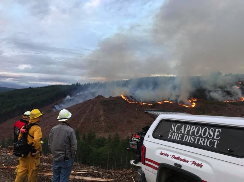 PHOTO COURTESY OF SCAPPOOSE FIRE DISTRICT - Fire crews were alerted to a wildfire off Scappose Vernonia Highway on Sunday afternoon, June 3. The fire was continuing to grow as of Monday morning, and multiple agencies were on scene working to contain and extinguish the fire.