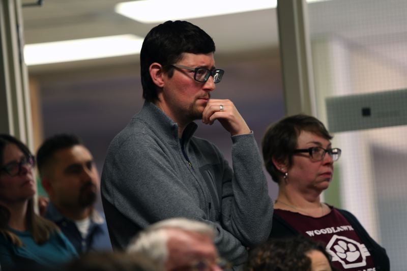 JESSIE DARLAND  - Jared Goodman waits anxiously as the school board begins their vote on where to relocate ACCESS.