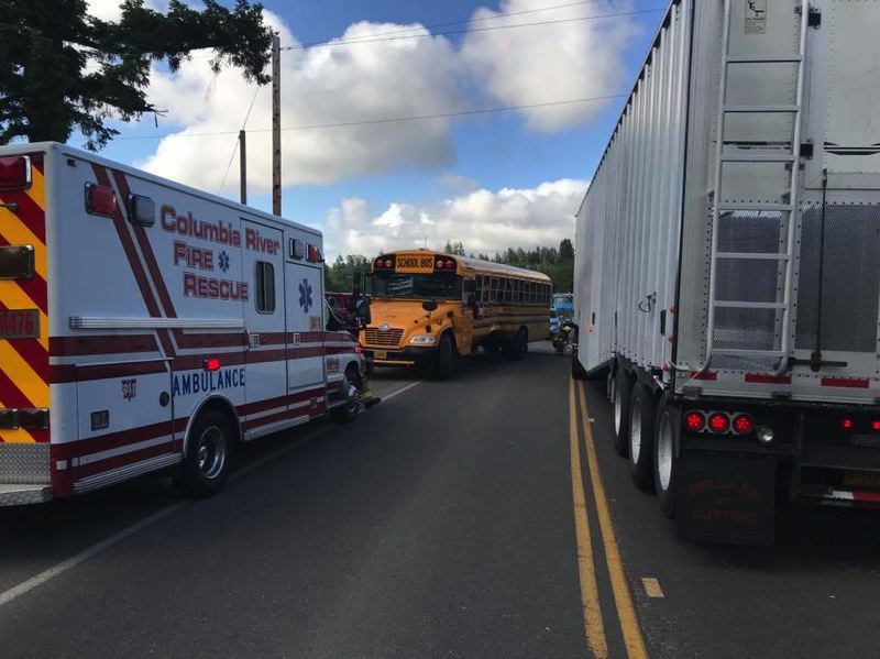 PHOTO COURTESY OF COLUMBIA RIVER FIRE AND RESCUE - Columbia River Fire and Rescue crews responded to a two vehicle crash involving a semi truck and school bus, Mondy morning, June 4. The driver of the truck was taken to an area hospital for minor injuries.