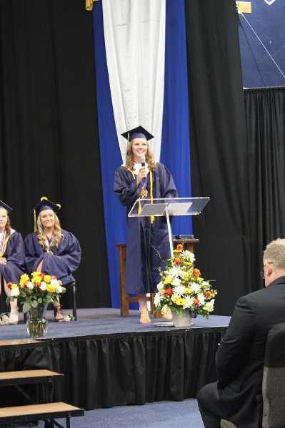 PIONEER PHOTO: KRISTEN WOHLERS - Class valedictorian Madeline Lewandowski addresses her classmates and the crowd on Sunday, June 3.