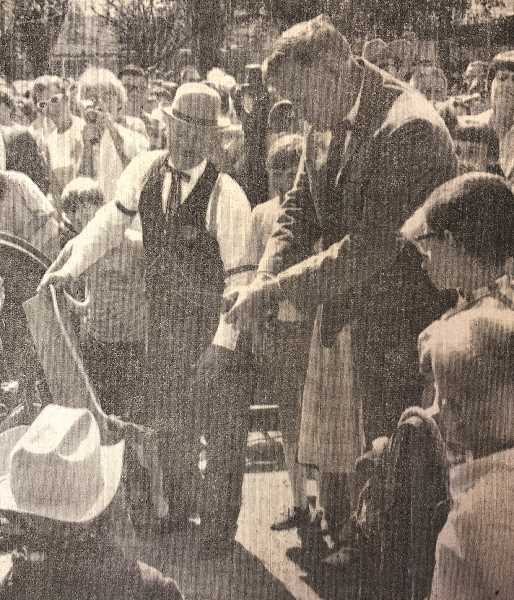 CENTRAL OREGONIAN FILE PHOTO  - June 6, 1968: THE MOMENT everyone has been waiting for — Governor Tom McCall's cutting of the rawhide ribbon marking the official opening of the Centennial Celebrations.