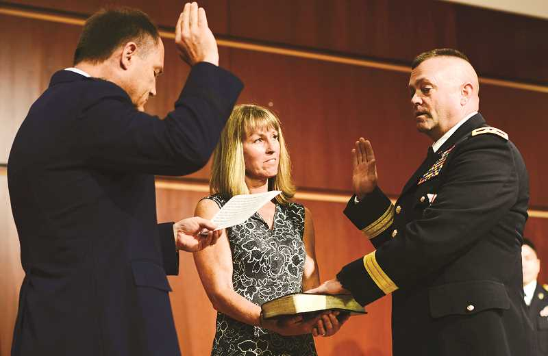 PHOTO COURTESY OF OREGON NATIONAL GUARD - Eric Bush is sworn in as a two-star major general in the Oregon National Guard during a ceremony in Clackamas this past Saturday.