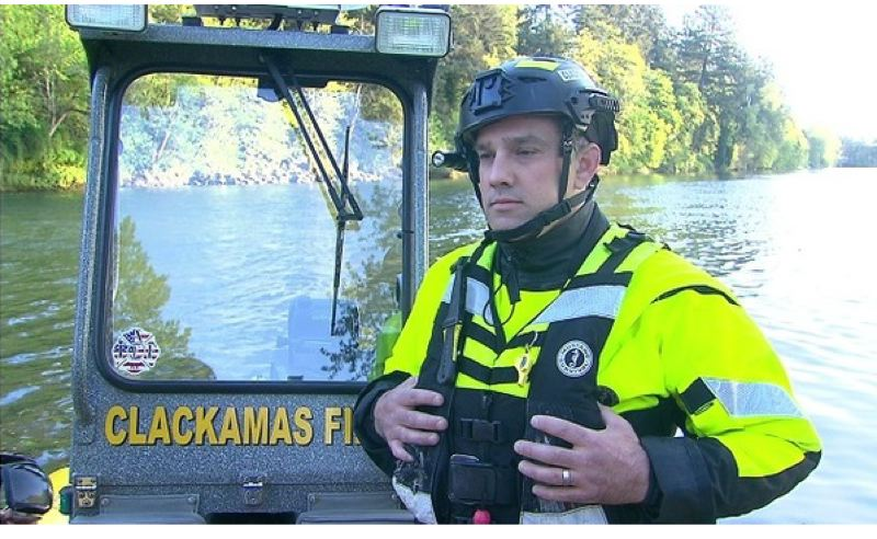 PHOTO BY: KOIN 6 NEWS - Dustin Mauck with Clackamas Fire discusses water rescues and how to be safe this summer.