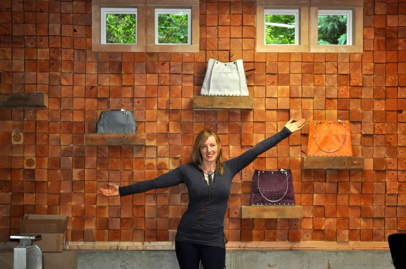 SUBMITTED PHOTO - Renee Sonnichsen shows off her strong, sexy, smart handbags, which will be for sale at the open studios event June 8, 9 and 10.