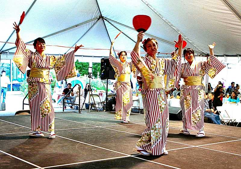 """DAVID F. ASHTON - """"Team Japanette"""" performs """"traditional dances to a rocking new beat"""", during Multicultural Night at Portland Community College's Southeast Campus on 82nd Avenue of Roses."""