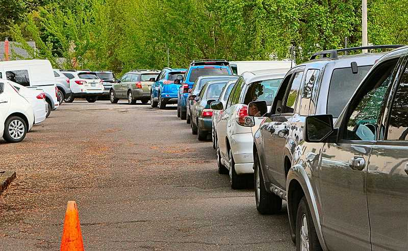 DAVID F. ASHTON - During the entire four-hour drug, document, and e-waste collection day, vehicles are lined up, bumper-to-bumper, around the former Southeast Precinct building.