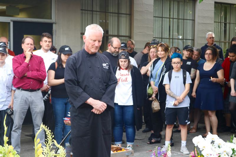 VALLEY TIMES PHOTO: ZANE SPARLING - Chef Brian Wilke calls for a moment of silence during a vigil for chef Daniel Brophy on Monday, June 4 in Portland.