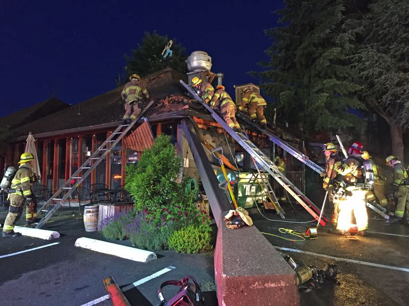 PHOTO: TVF&R - Crews work to save a McMenamins restaurant in Raleigh Hills, Tuesday, June 5.
