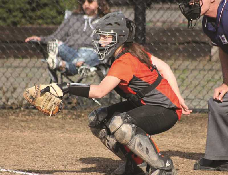 FILE PHOTO: CONNER WILLIAMS - Molalla senior Emily Gates was awarded first team all-league honors for her work as the softball teams catcher this past season.
